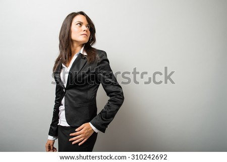 Business woman looking over her shoulder - stock photo