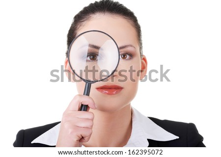 Business woman looking through magnifying glass. Isolated on white. - stock photo