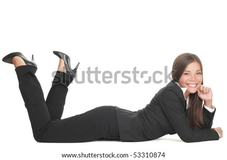 Business woman lying down on floor isolated on white smiling looking at camera. Young mixed race Chinese Asian Caucasian businesswoman. - stock photo