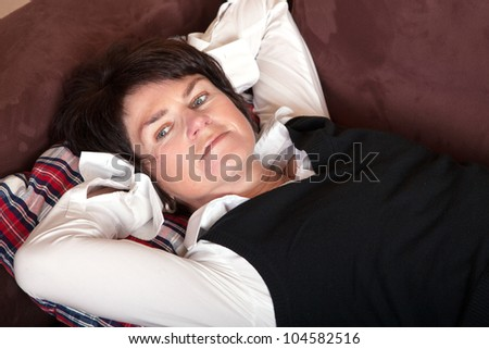Business woman lying on the couch, recovering