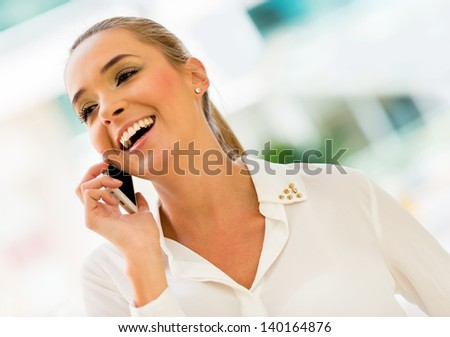 Business woman making a call on her cell phone - stock photo