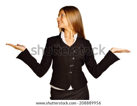 Business woman making a scale with her arms wide open, isolated in a white background - stock photo