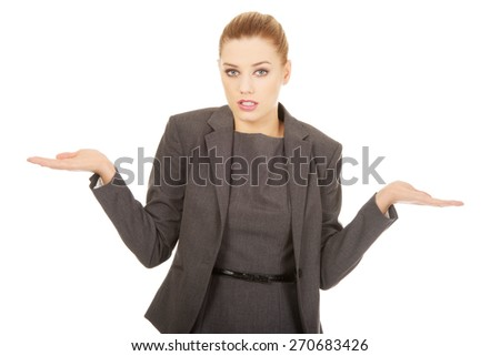 Business woman making undecided gesture. - stock photo