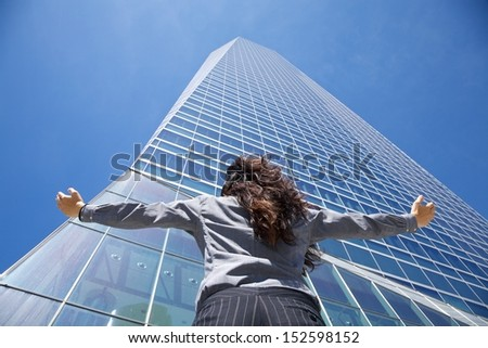 business woman next to skyscrapers in Madrid city Spain