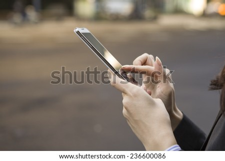 Business Woman of operating the mobile phone - stock photo