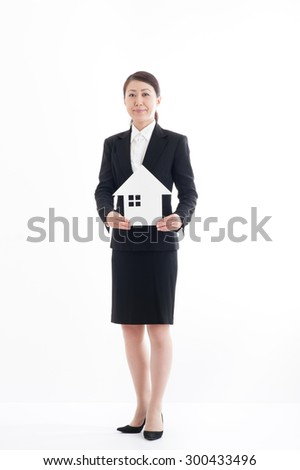Business Woman of the suit to have a model of the house