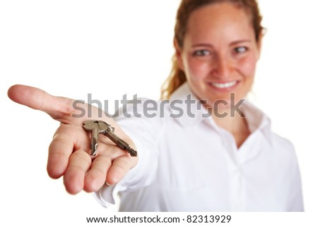 Business woman offering two keys on her open palm - stock photo