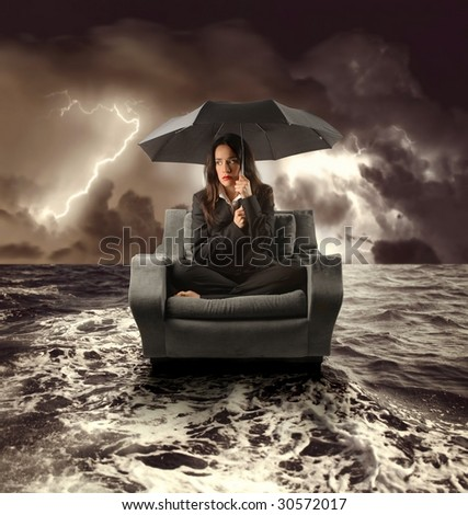 business woman on an armchair lost in the sea during a storm - stock photo