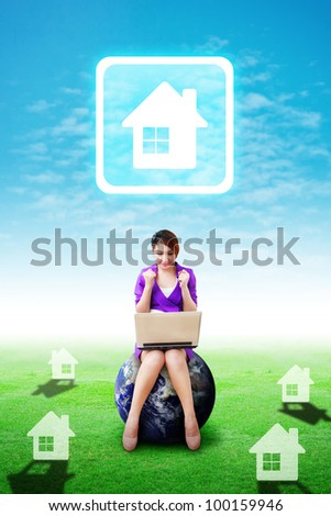 Business woman on grass field and present the House icon : Elements of this image furnished by NASA - stock photo