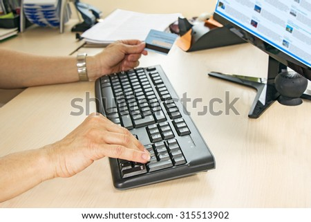 Business woman On line Shopping, using laptop and credit card