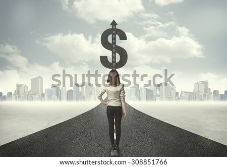 Business woman on road heading toward a dollar sign concept - stock photo