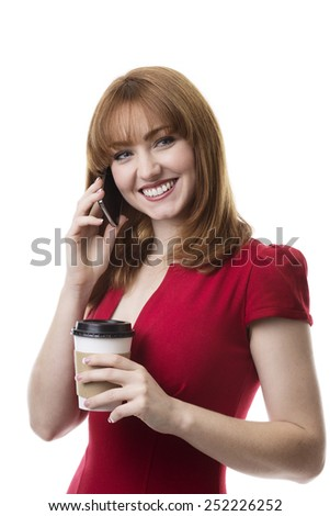 business woman on the phone and holding a take away paper cup of coffee or tea