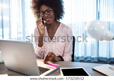 Business woman on the phone at office