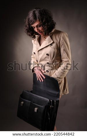 business woman opening a suitcase - stock photo