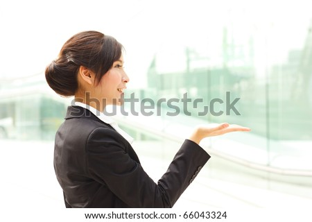 Business woman paying attention to your message or product - stock photo