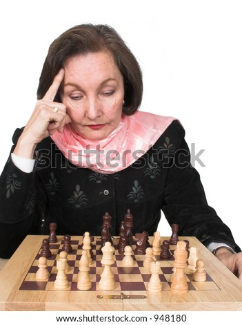 business woman planning her next move on a chess game - stock photo