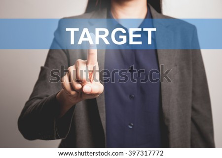 Business woman pointing at word of Target - stock photo