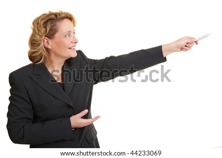 Business woman pointing with her pen rightward - stock photo