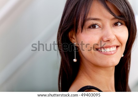 Business woman portrait at the office smiling - stock photo