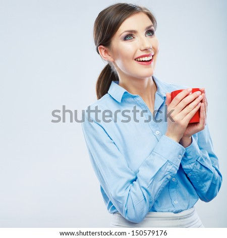 Business woman portrait hold red coffee cup. Female model drink tea. - stock photo