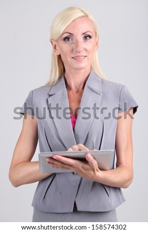 Business woman portrait on grey background