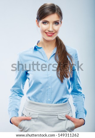Business woman portrait. Smiling young student girl.  blue shirt dressed. - stock photo
