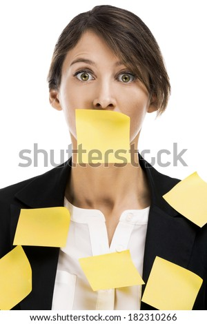 Business woman portrait with yellow paper notes on the face, isolated over a white background - stock photo