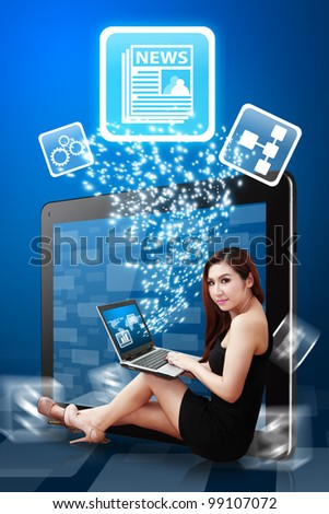 Business woman present the News icon from tablet pc