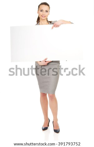 Business woman presenting empty banner. - stock photo