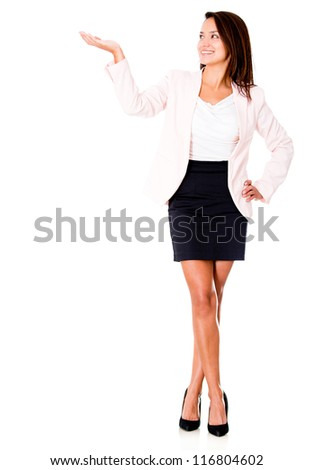 Business woman presenting something with her hand - isolated - stock photo