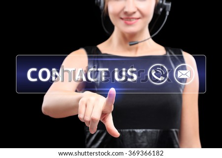 business woman presses a button on the touch screen. contact us - stock photo
