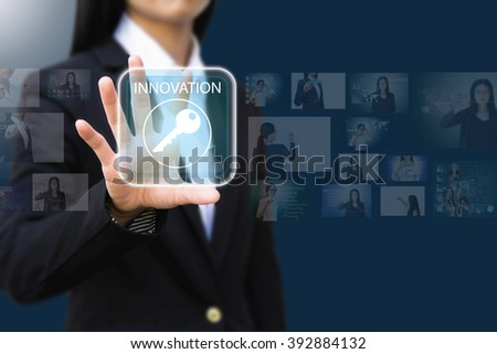 business woman pressing a  innovation concept button