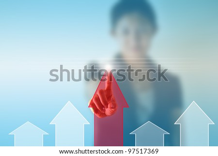 Business woman pressing chart - stock photo