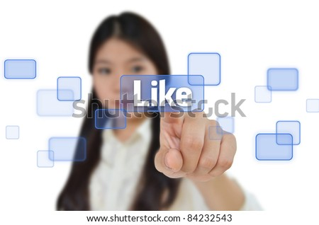 Business woman pressing like button on screen - stock photo