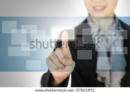 Business woman pressing on  buttons - stock photo