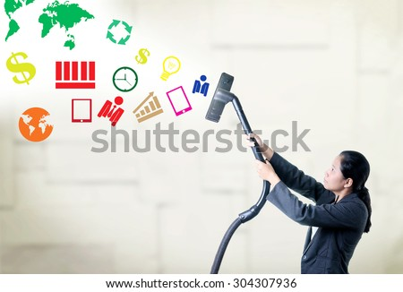 Business woman pull some thing from air by vacuum cleaner. - stock photo