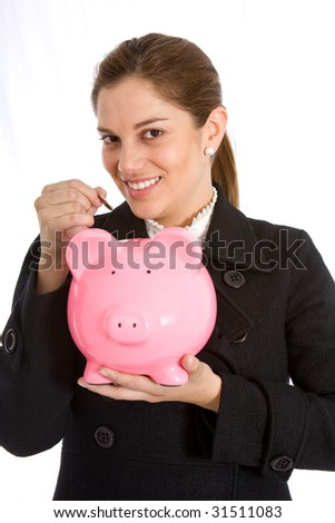 business woman puting her savings in a piggy bank