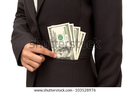 Business woman putting dollar bills U.S. banknotes into her pocket on white background.
