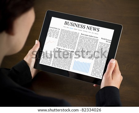 Business woman reading business news on the touch screen device. - stock photo