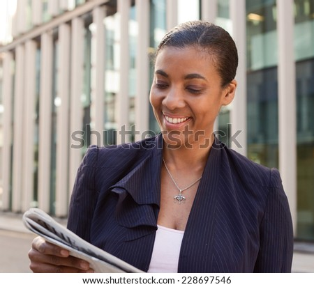 business woman reading the newspaper.