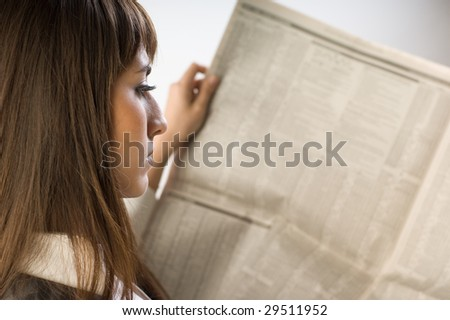 Business Woman reading the newspaper - stock photo