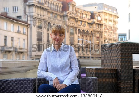 business woman relaxing on office terrace