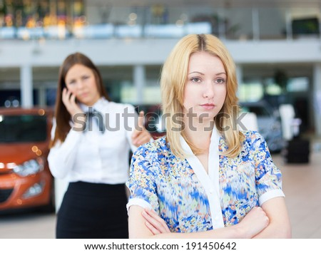 business woman resolving problem of dissatisfied customer woman by phone. Selective focus. - stock photo