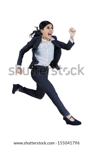 Business woman running in suit in full body isolated on white background. - stock photo