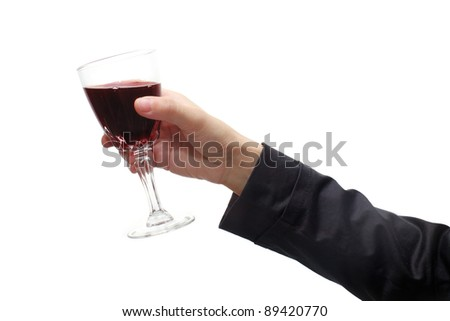 Business woman's hand with red wine
