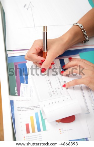Business woman's hands and check book.