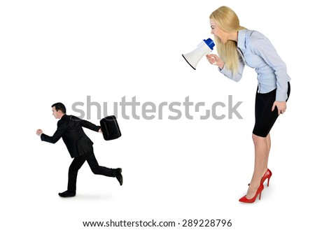 Business woman screaming on megaphone on little man - stock photo