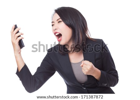 Business woman screaming or shouting at phone