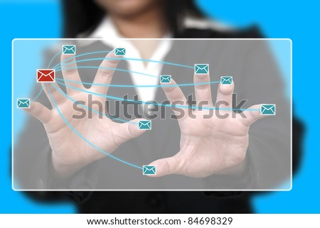 business woman send e-mail by touching modern touchscreen - stock photo