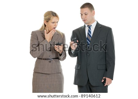 Business woman shocked by text message - stock photo